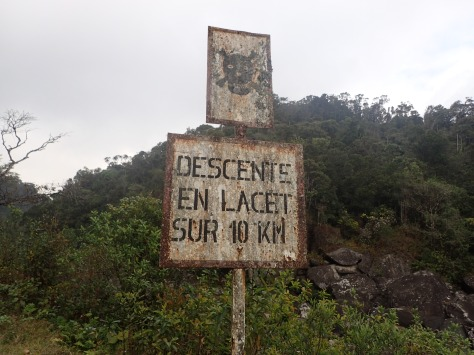 A warning sign near a dangerous part of a trail